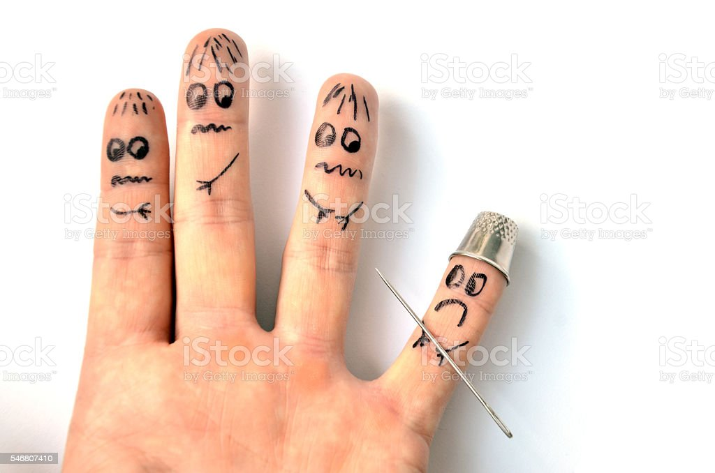 Finger armed by needle puts in fear another fingers stock photo
