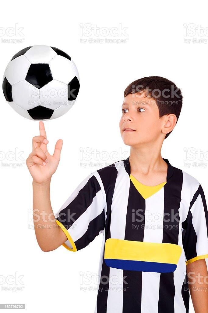Finger balancing football royalty-free stock photo