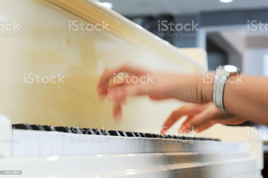 Finger blurof a pianist stock photo