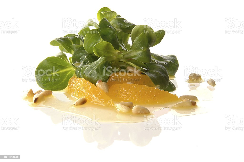 Finger food with orange, field salad and pine nuts royalty-free stock photo