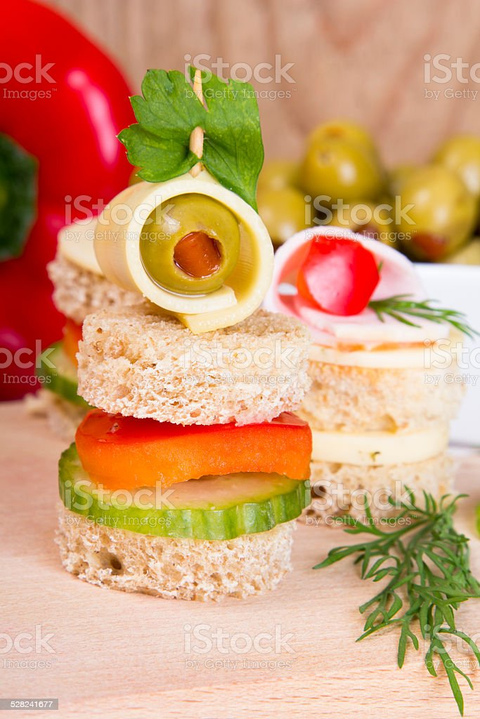 finger foods: bread, peppers, cucumber, cheese and olives stock photo