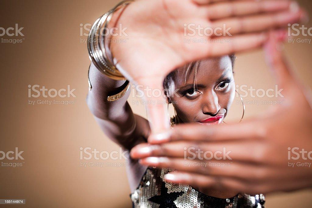 Finger Frame Beautiful Black Woman Posing Looking at Camera royalty-free stock photo