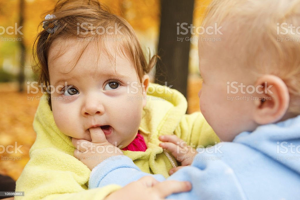 Finger in mouth stock photo