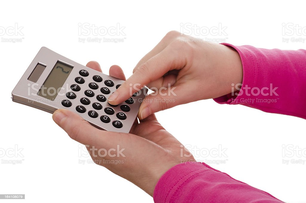 Finger is typing on a pocket calculator stock photo