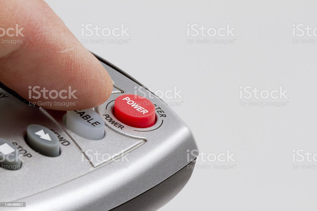 Finger next to cable remote power button stock photo