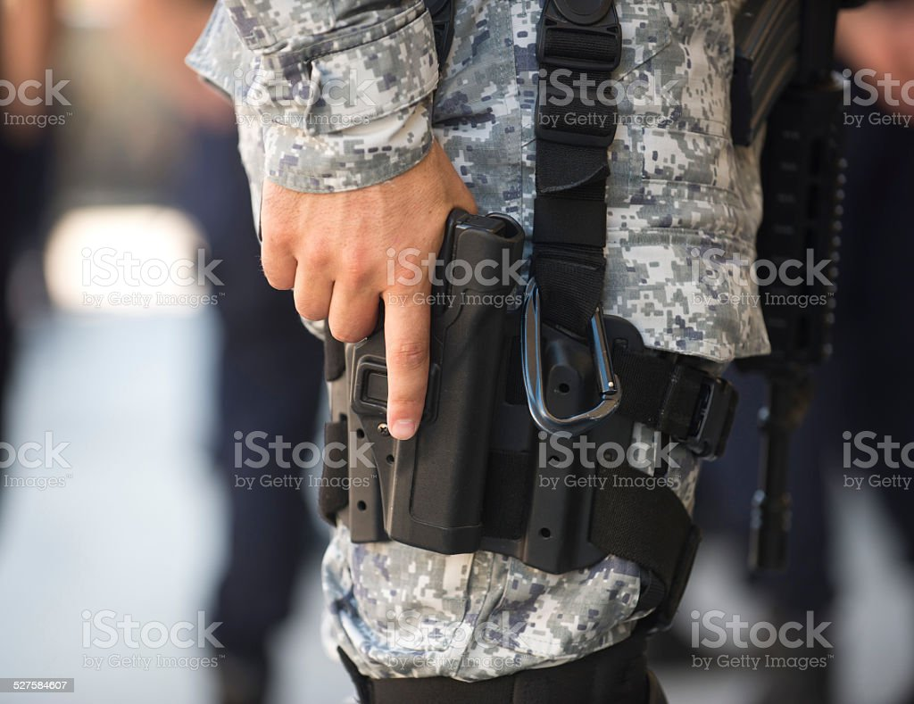 Finger on a trigger, law enforcement stock photo