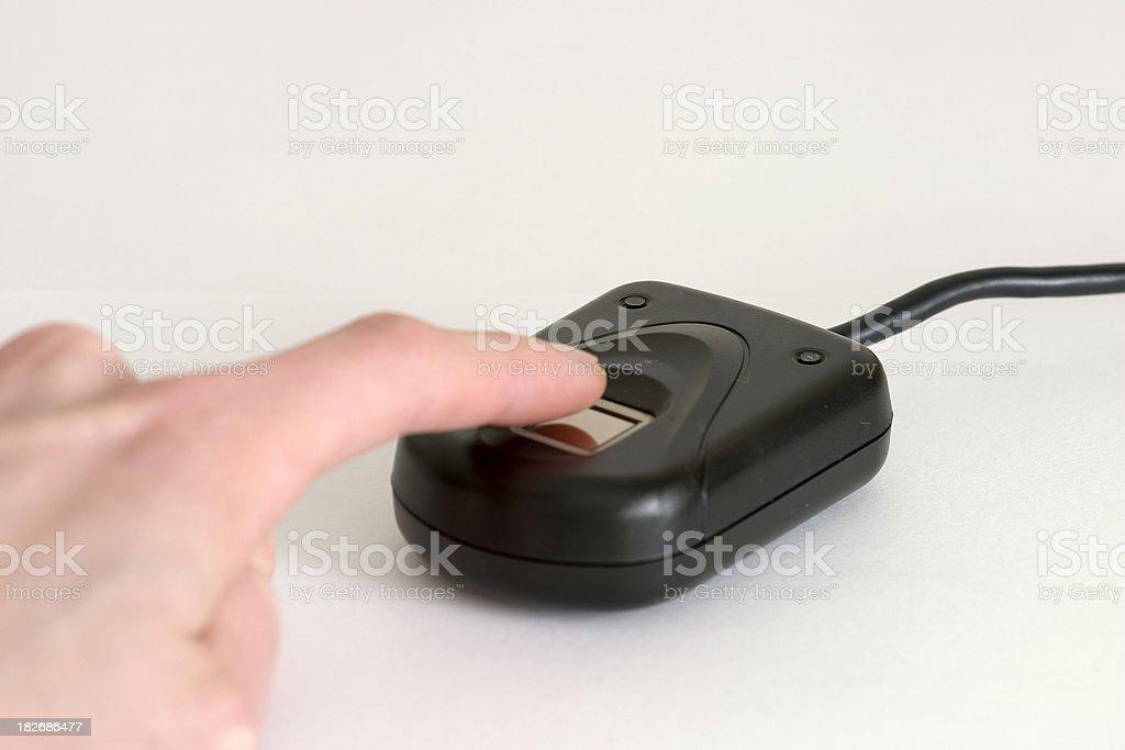 Finger on biometric fingerprint reader stock photo