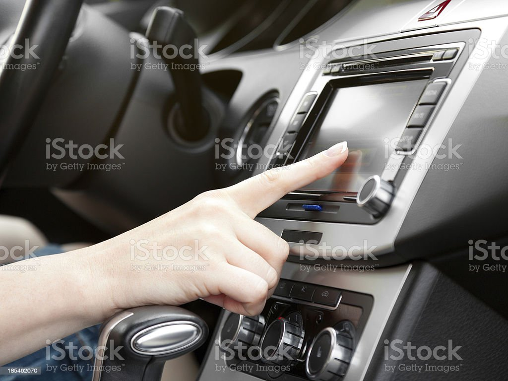finger on dashboard with gps panel stock photo