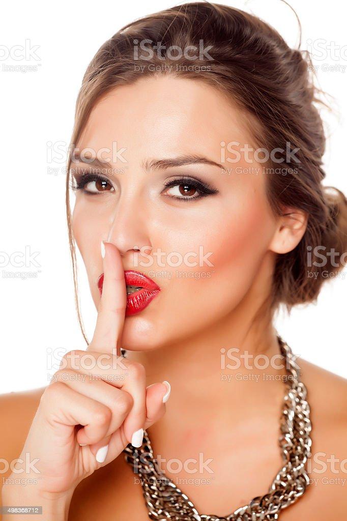 finger on her lips stock photo
