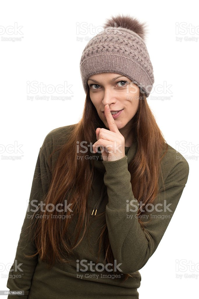 finger on her lips. silence gesture stock photo