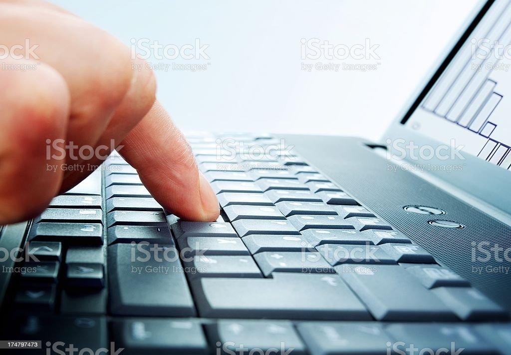 Finger on laptop stock photo