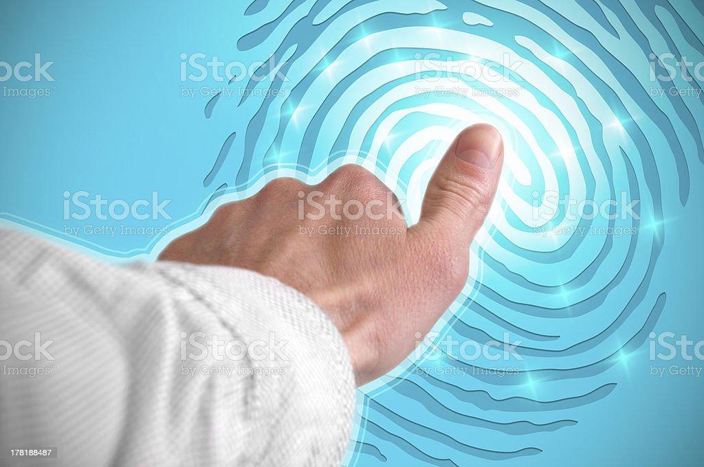 Finger on light screen stock photo