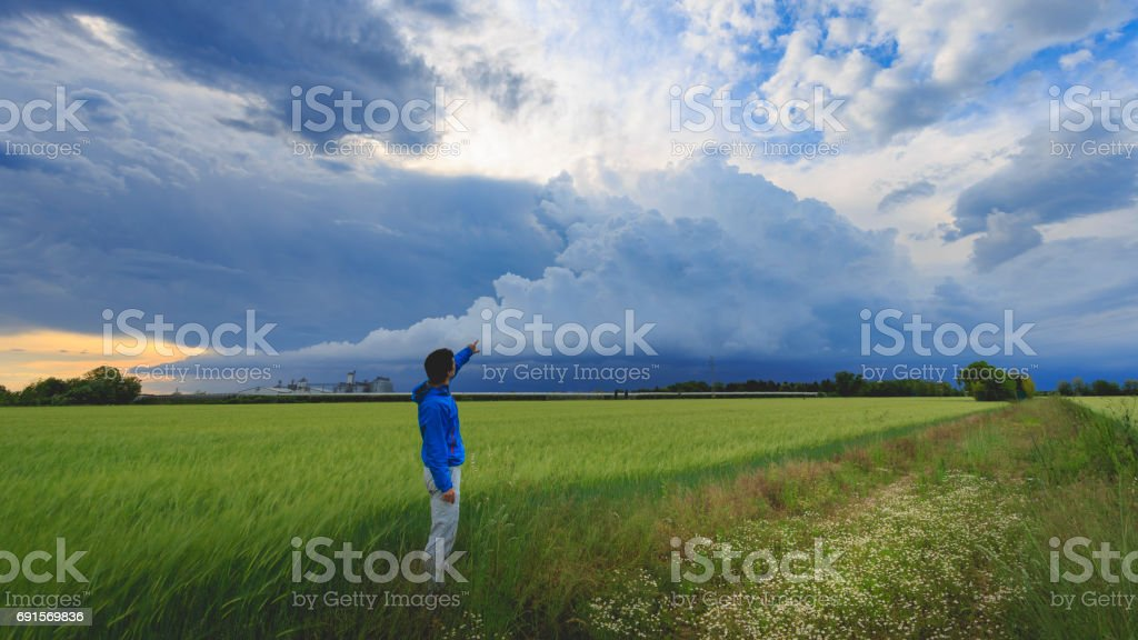 Finger on the clouds stock photo