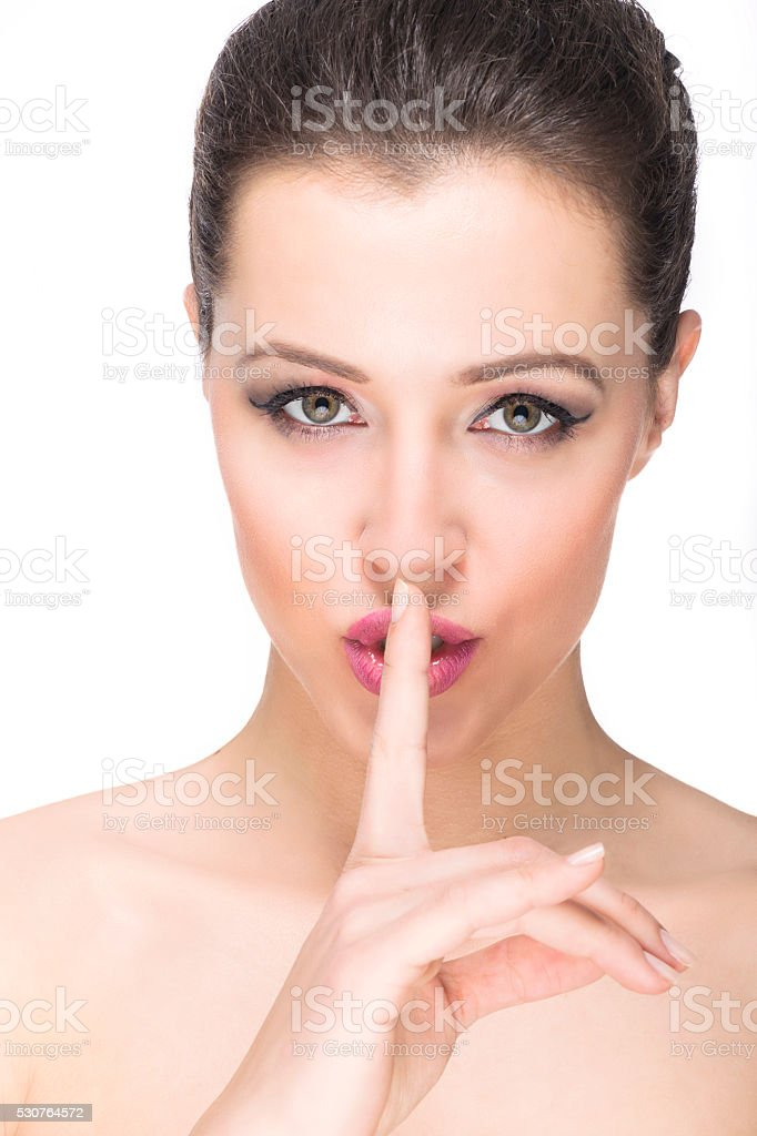 finger on the lips stock photo