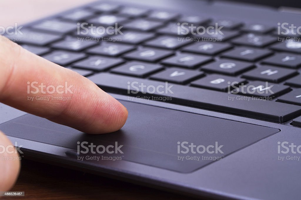 Finger on Touch Pad stock photo