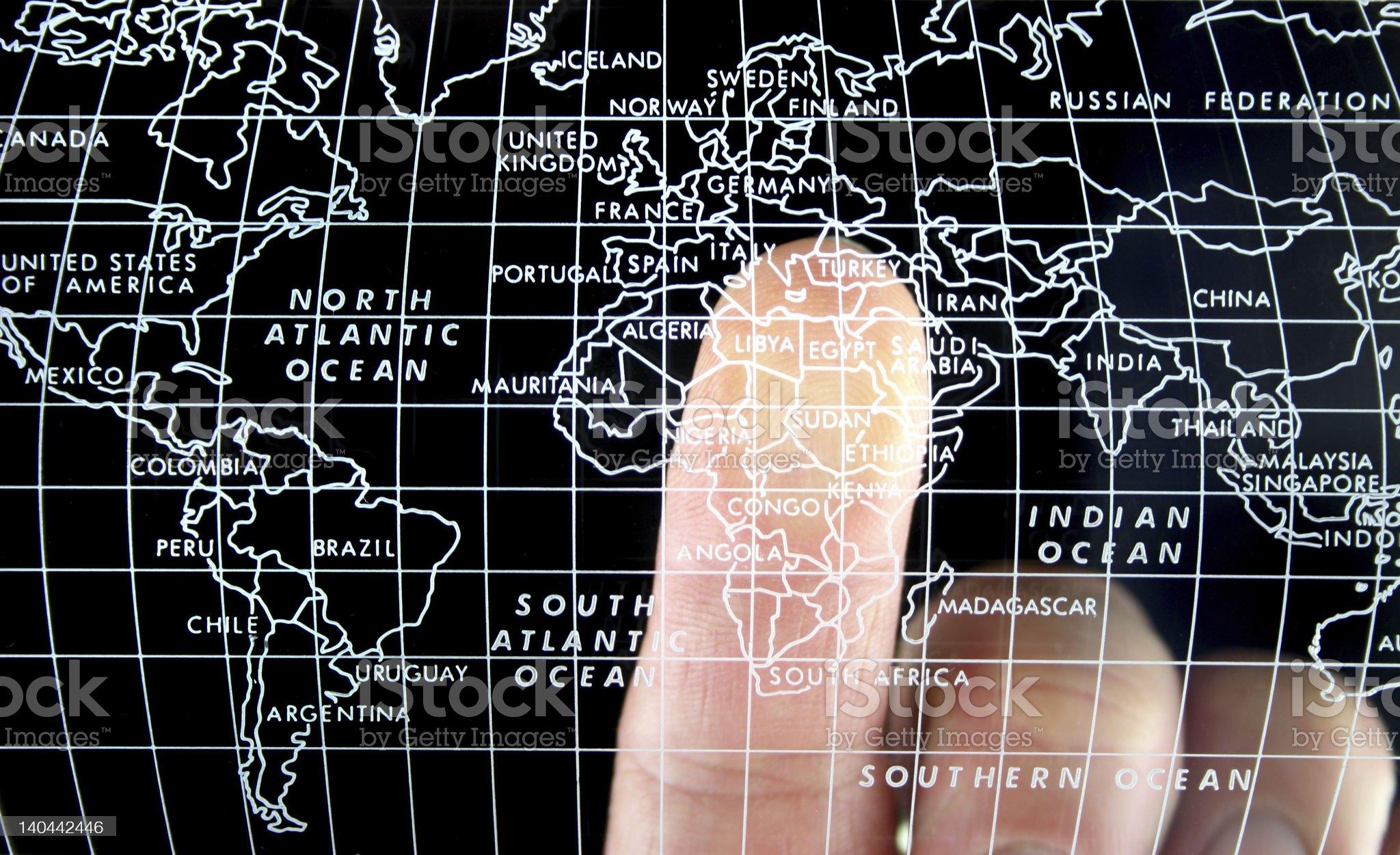 Finger on World Map - Europe royalty-free stock photo