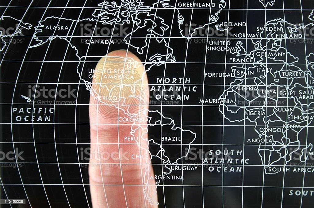 Finger on world Map royalty-free stock photo