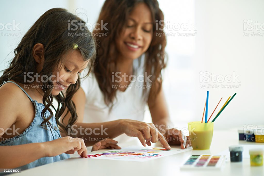 Finger painting lesson stock photo
