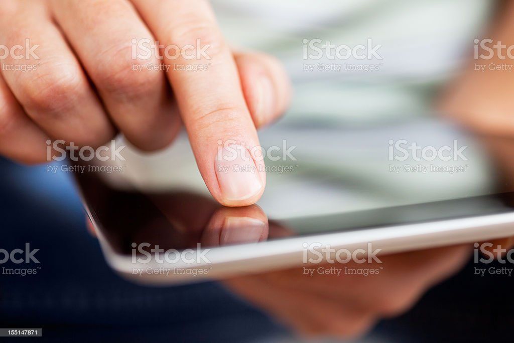 Finger Pointing on Digital Tablet. royalty-free stock photo