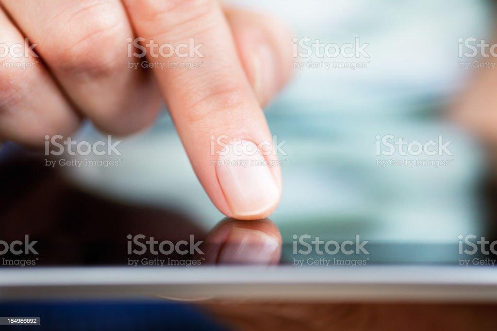 Finger Pointing on Digital Tablet. stock photo
