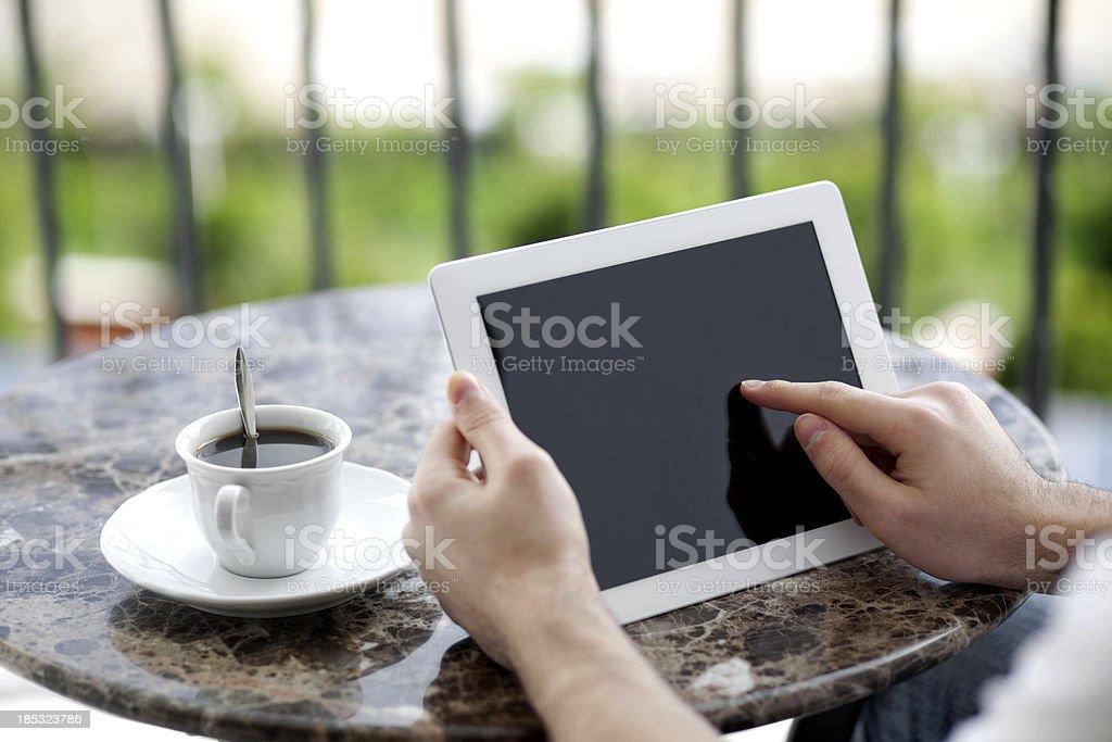 Finger pointing on digital tablet stock photo
