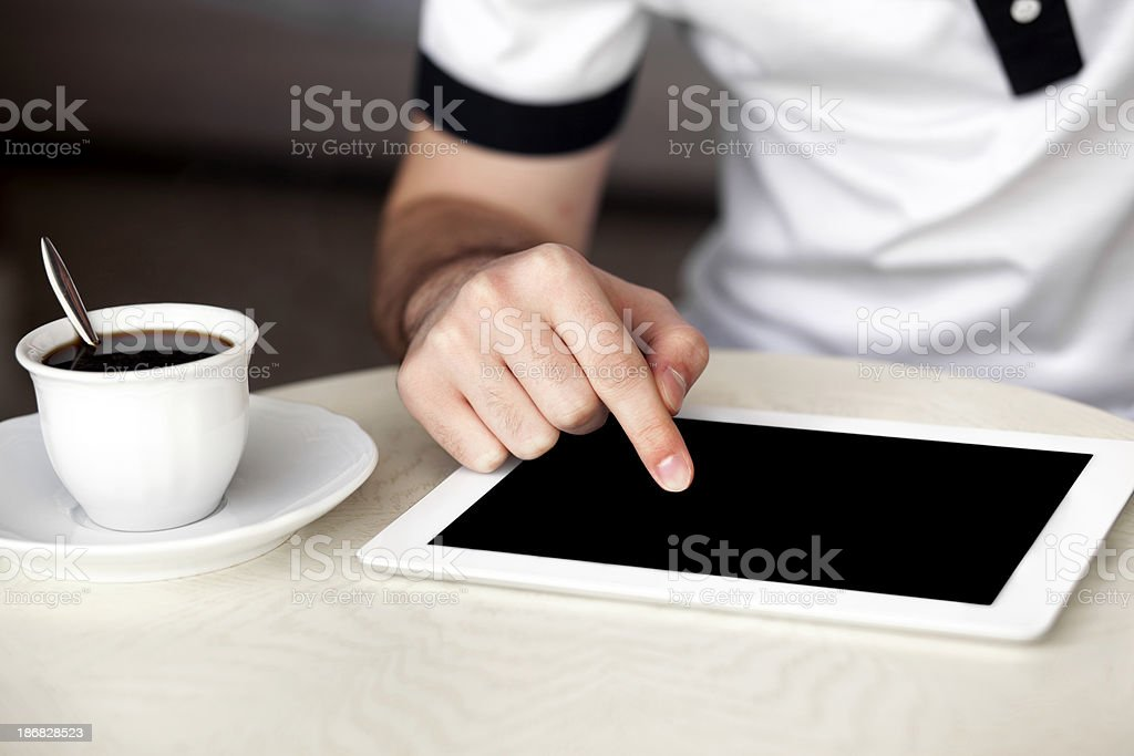 Finger pointing on digital tablet royalty-free stock photo