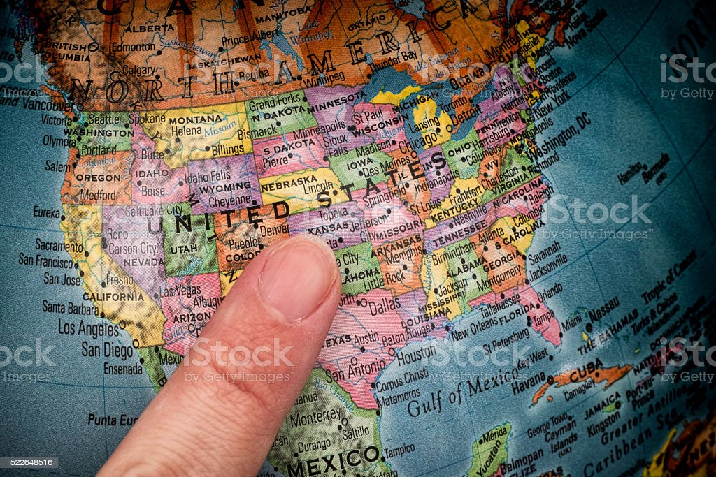 Finger pointing to USA on a globe stock photo