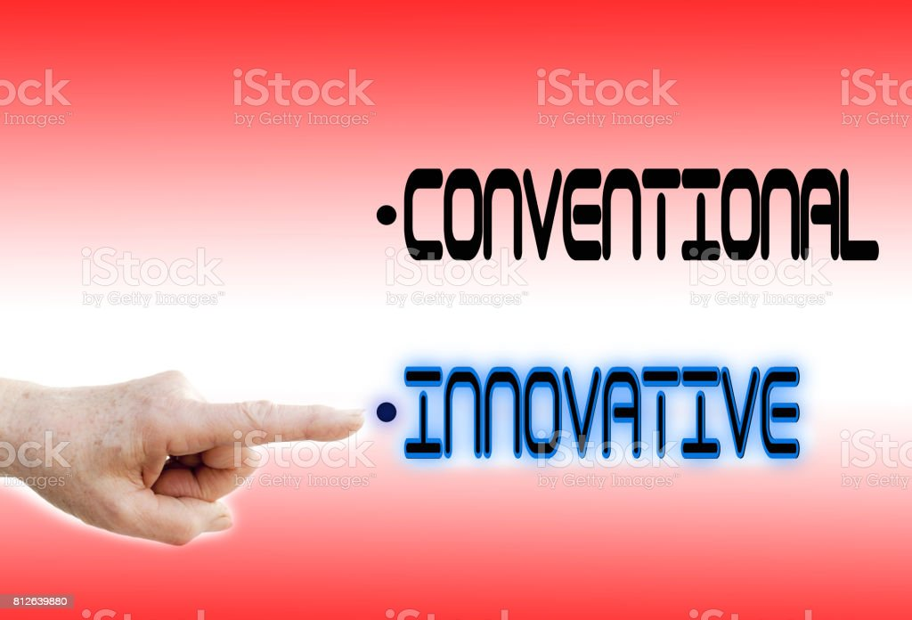 Finger points to Innovative instead of Conventional stock photo