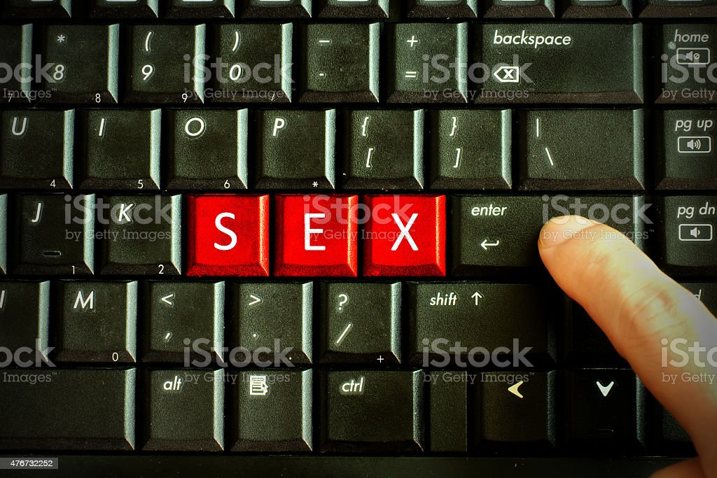 Finger press red button Keywords SEX on keyboard computer, Adult stock photo