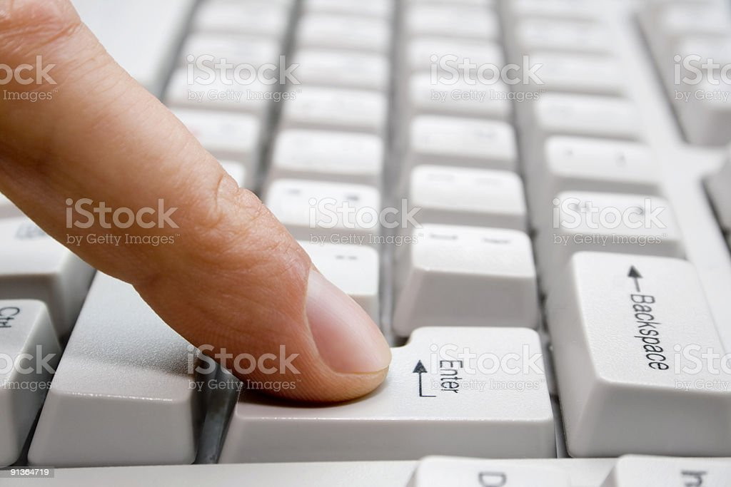 finger presses the key stock photo