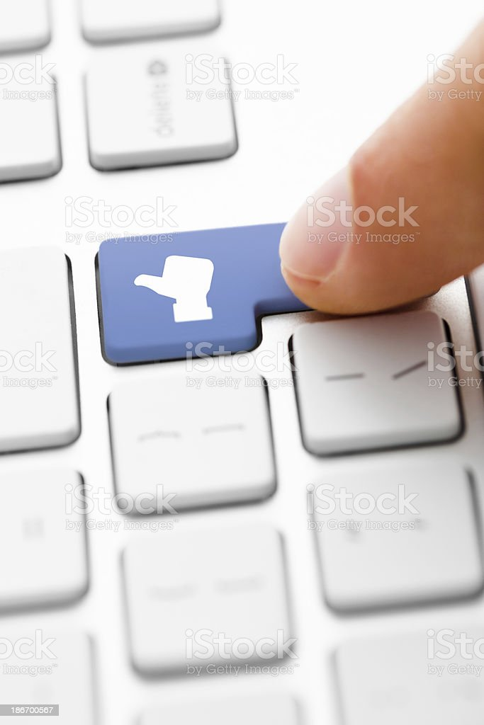 Finger Pressing a Like Key royalty-free stock photo