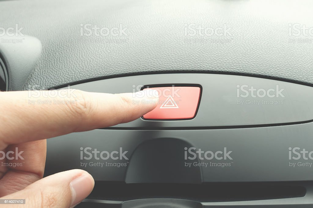 Finger pressing car emergency button stock photo