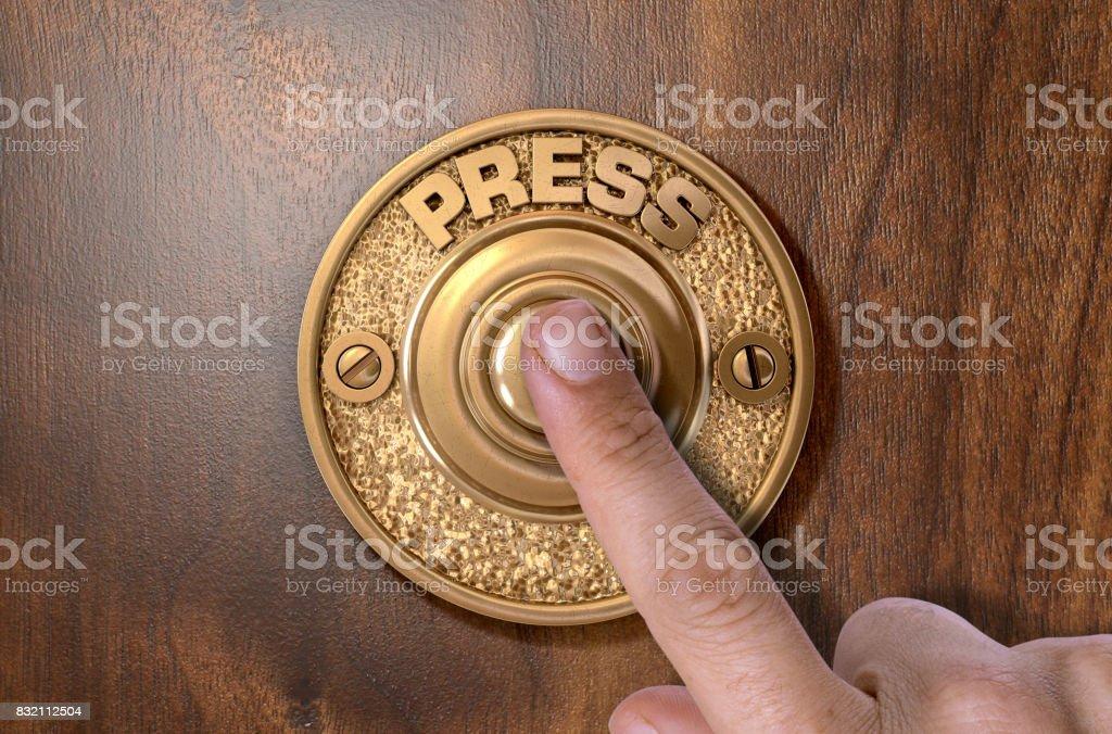 Finger Pressing Doorbell stock photo