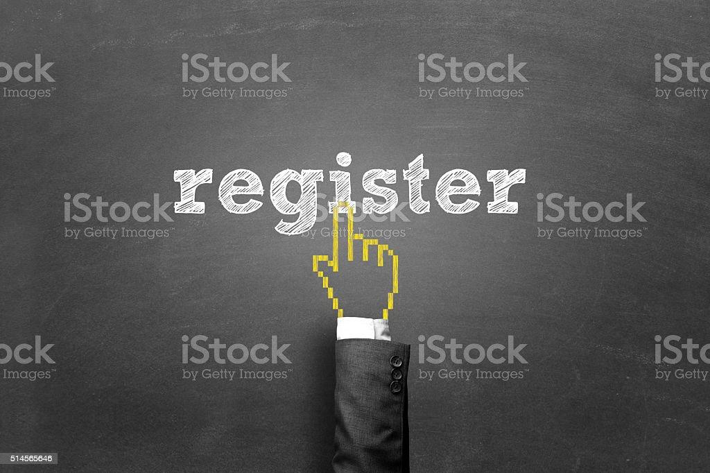 Finger pressing register button on a blackboard stock photo