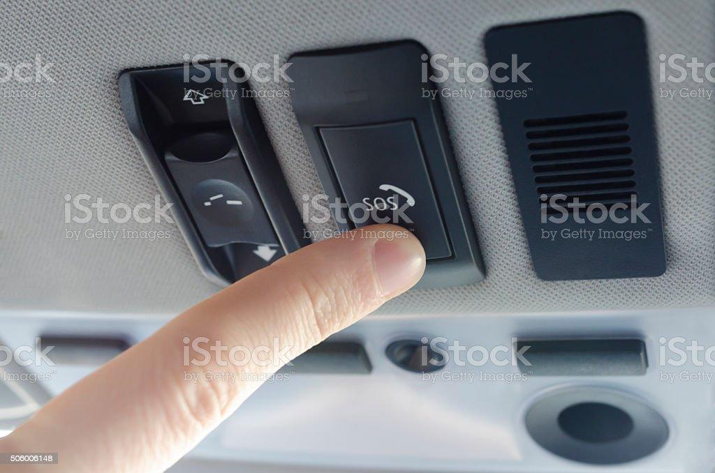 Finger pressing sos button stock photo
