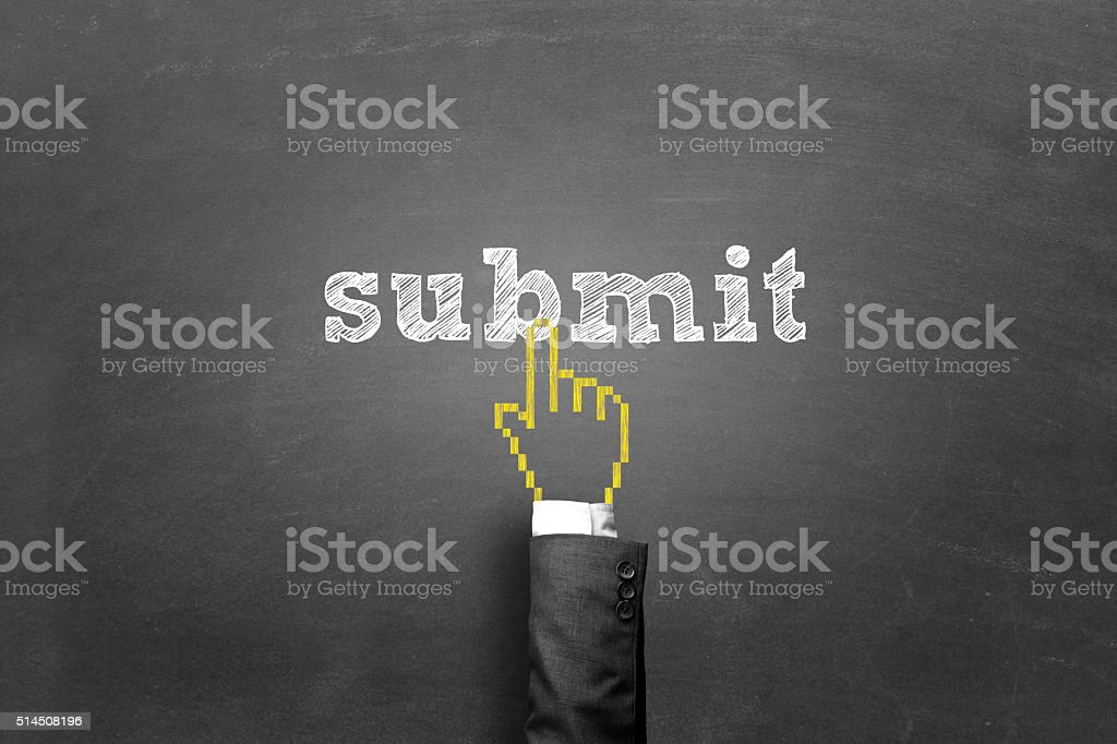Finger pressing submit button on a blackboard stock photo