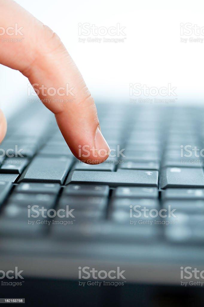 Finger pushing button on keyboard stock photo