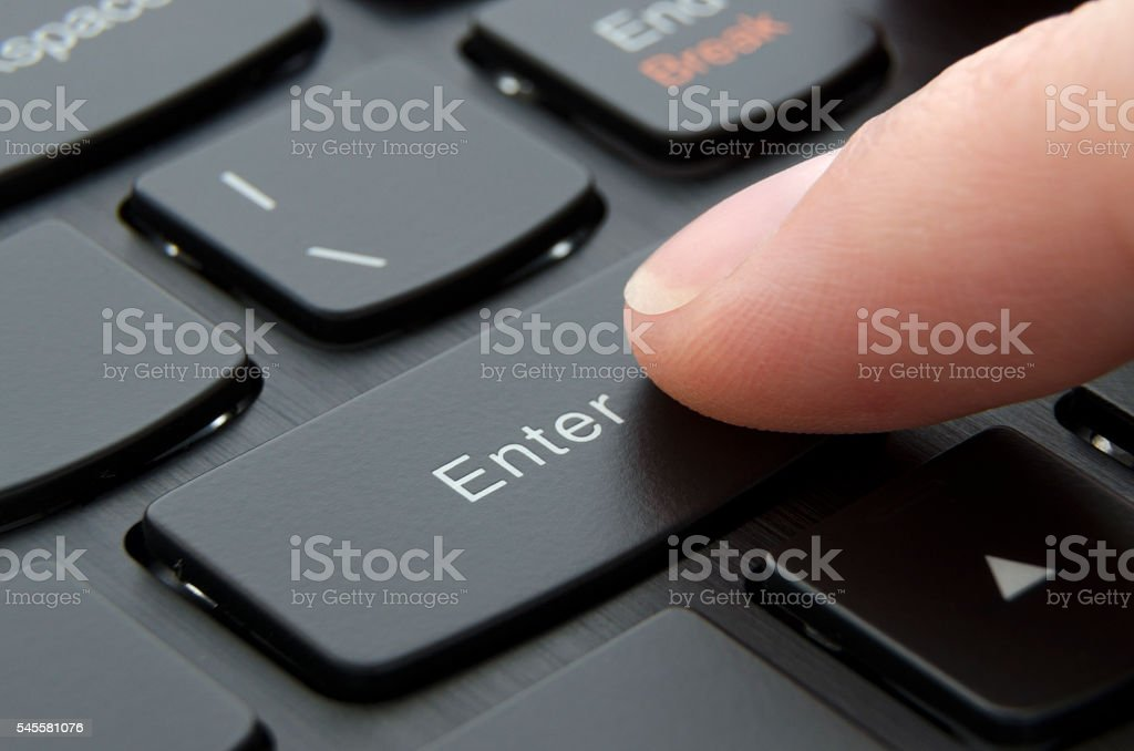 Finger pushing enter black button stock photo