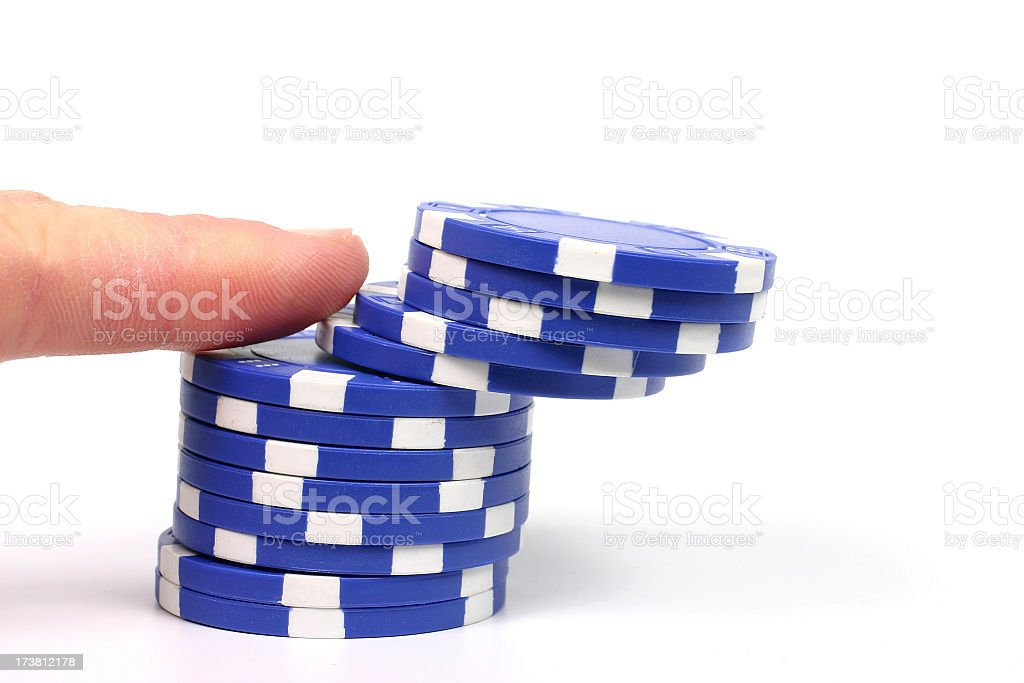 Finger pushing over blue poker chips royalty-free stock photo