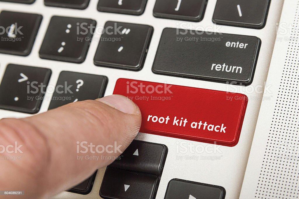 Finger pushing red root kit attack key on keyboard stock photo