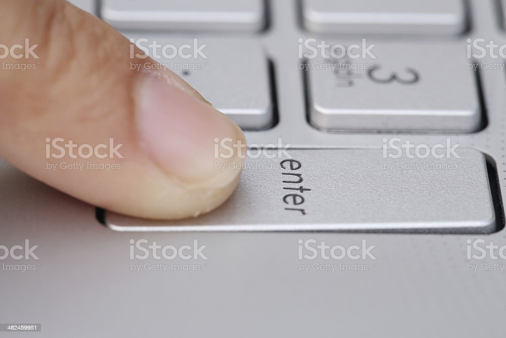 finger pushing the button of keyboard stock photo