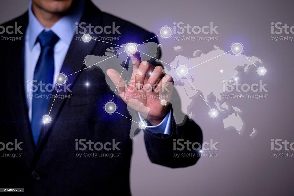 Finger pushing the world map stock photo