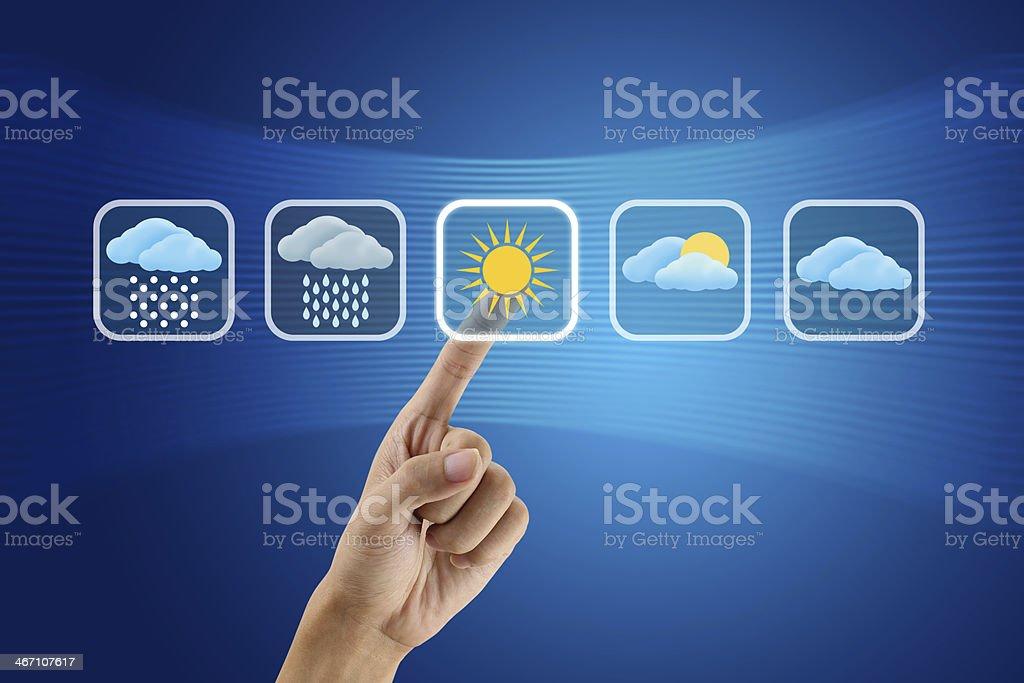 finger pushing Weather icon stock photo
