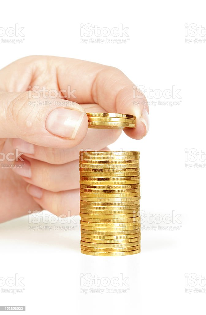 Finger put coins on coin-stack stock photo