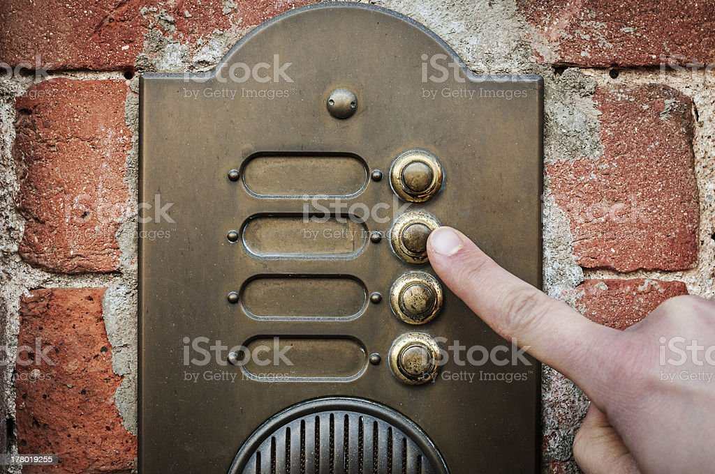 Finger ringing a door bell stock photo