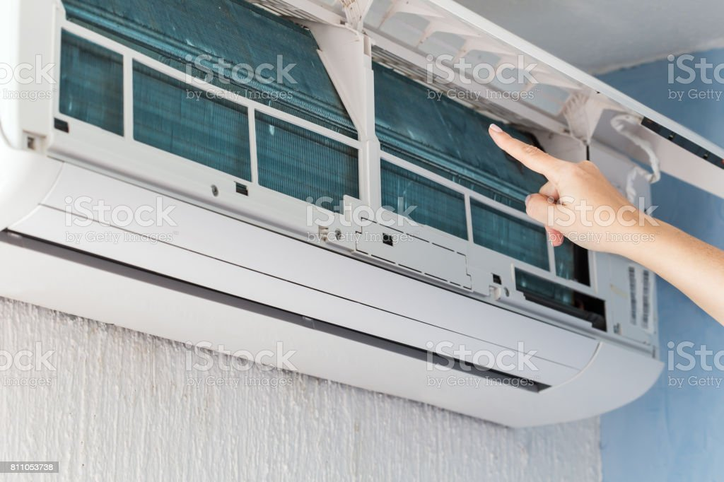Finger show on dirty filter of air conditioner stock photo