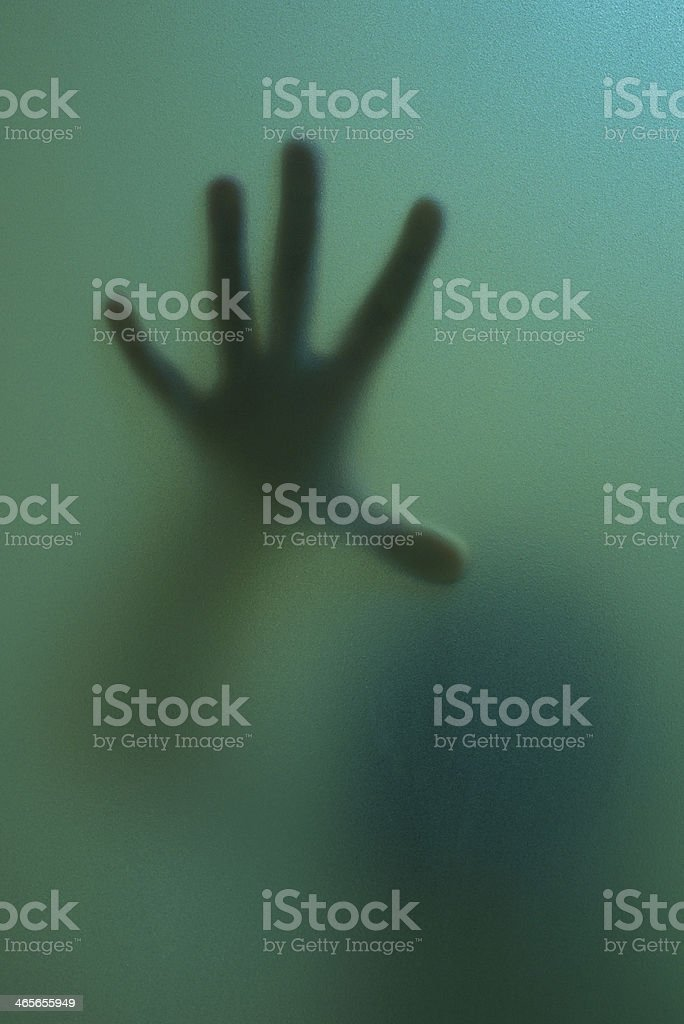 finger touch to frosted glass stock photo