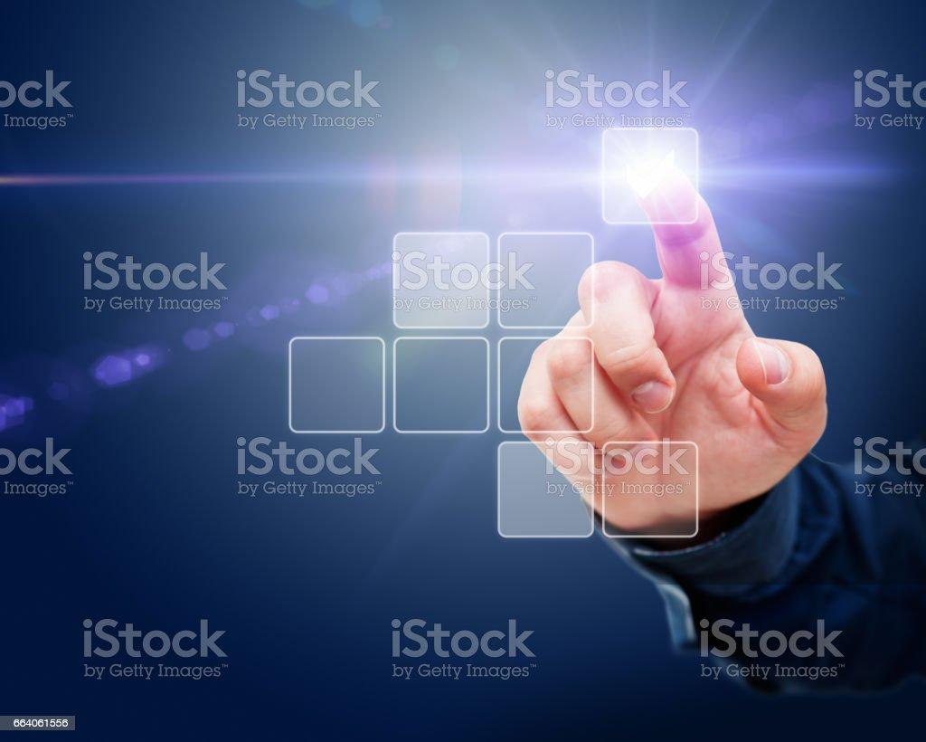 Finger Touching a Digital Screen stock photo