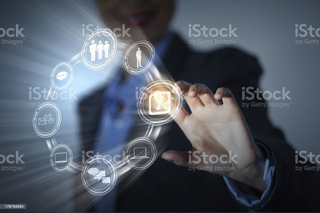 A finger touching an icon on the screen royalty-free stock photo