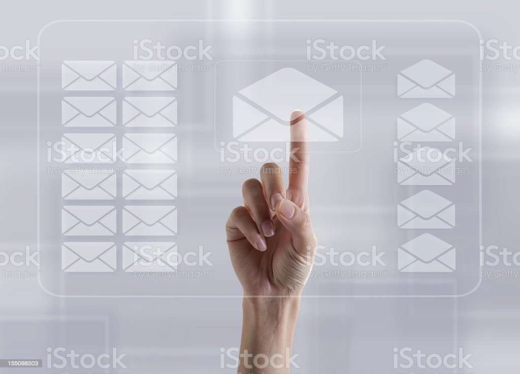 Finger Touching E-mail sign on Transparent Digital Touch Screen stock photo
